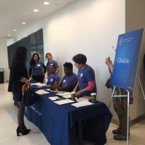 Job fair volunteers help check-in job seekers and recruiters